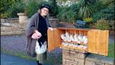 Breezy fills a box with delicious homemade scones and bread for the people of Glenties