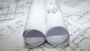 Plans to demolish partially built properties and garages in a busy Donegal town to make way for new housing development