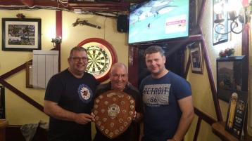 Two champions following darts double in Roddy's pub in Glenties, Donegal
