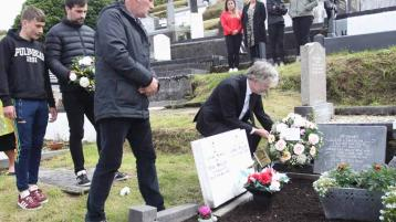 Australian Embassy's Head of Mission lays wreaths at the grave of Mary Ellen Molloy. Photo courtesy of John McConnell