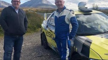 John Toal gets into the co-driver's seat with rally stalwart Gavin Kelly under the shadow of Errigal mountain tonight