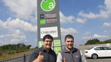 Hot offer - Massive queues form as motorists flock to filliing stations for cut price fuel as part of birthday celebrations