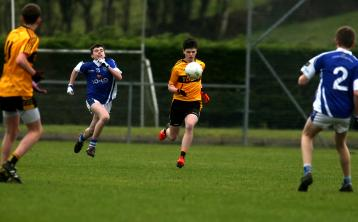 Brendan Horgan of St. Eunan's comes out of defence against St Peter's, Warrenpoint during the Paul McGirr U-16 Ulster final at Dromore on Saturday. Photo Thomas Gallagher INDD051216 TG1